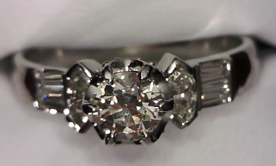 Custom ring using customers diamonds to hand down from one generation to the next.